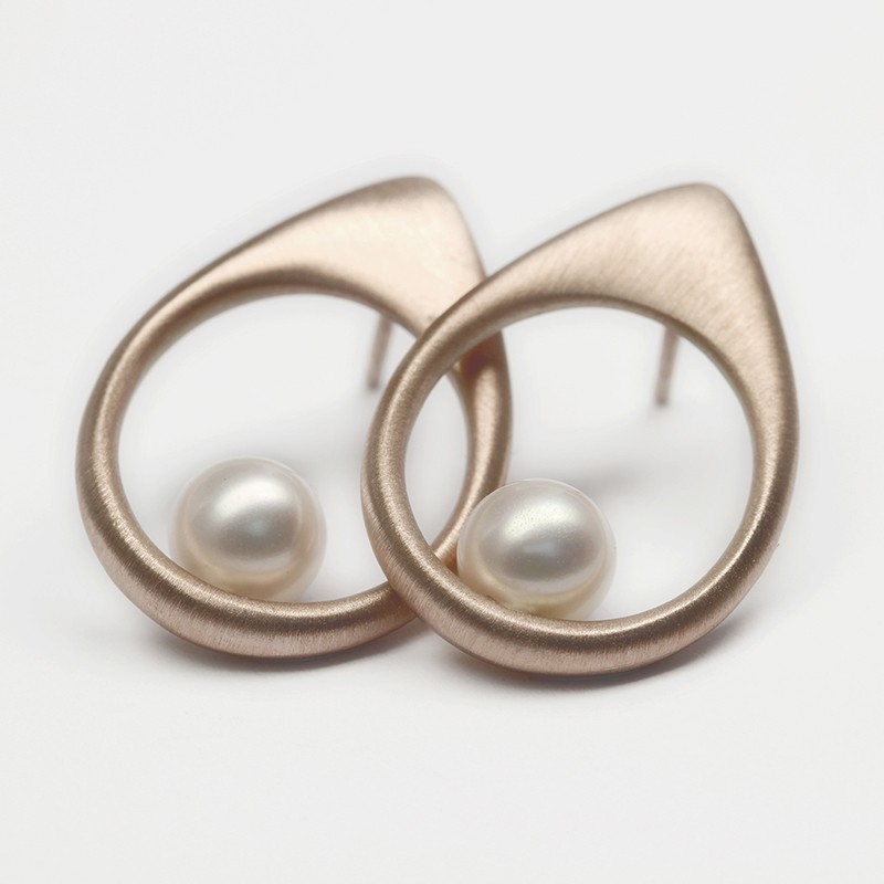 Simple silver earrings with pearl